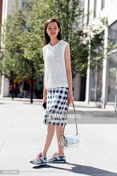 Chinese model Fei Fei Sun exits the Michael Kors show at Spring Studios on September 16 2015 in New York City Fei Fei wears white meshpatterned...