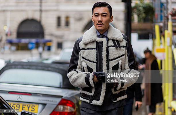 Chinese model Hu Bing wearing a leather jacket and sunglasses during London Fashion Week Men's January 2017 collections at Belstaff on January 9 2017...