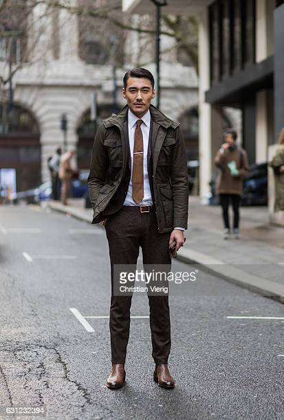 Chinese model Hu Bing wearing a puffy jacket and brown suit during London Fashion Week Men's January 2017 collections at Ximon Lee on January 8 2017...