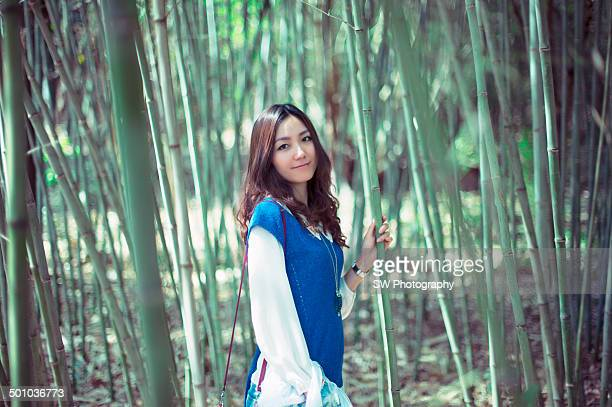 Chinese model inside of a bamboo forest