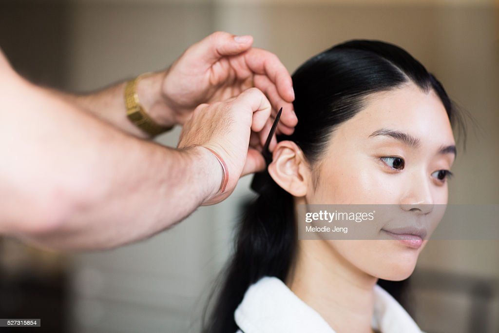Chinese model <a gi-track='captionPersonalityLinkClicked' href=/galleries/search?phrase=Ming+Xi&family=editorial&specificpeople=7182657 ng-click='$event.stopPropagation()'>Ming Xi</a> prepares before the 2016 'Manus x Machina' Met Gala at the Mark Hotel on May 02, 2016 in New York, New York. Manicure by Sheril Bailey.