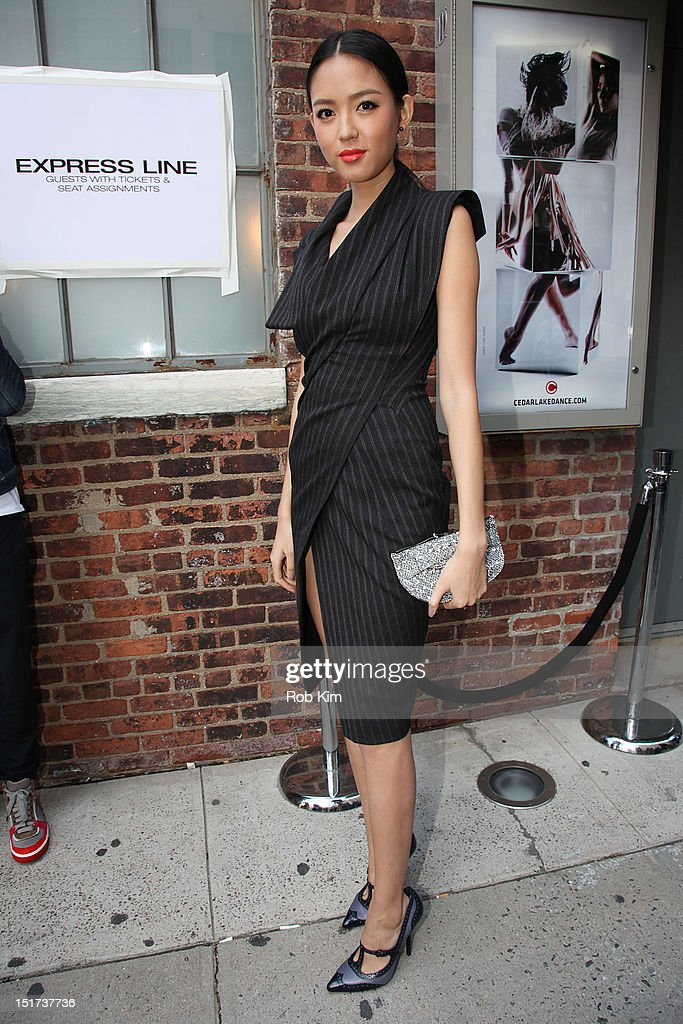 A chinese model wearing a Donna Karan dress arrives for Donna Karan's fashion show on September 10, 2012 in New York City.