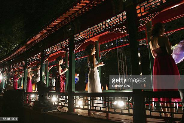 Chinese models present creations to promote the Chinese brand 'Ejoyous' during a fashion show held at the former residence of Song Qingling wife to...