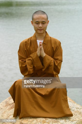 A Chinese monk posing in traditional clothing. : Photo