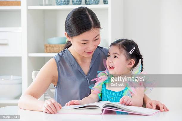 Chinese Mother  and Toddler Reading at Home