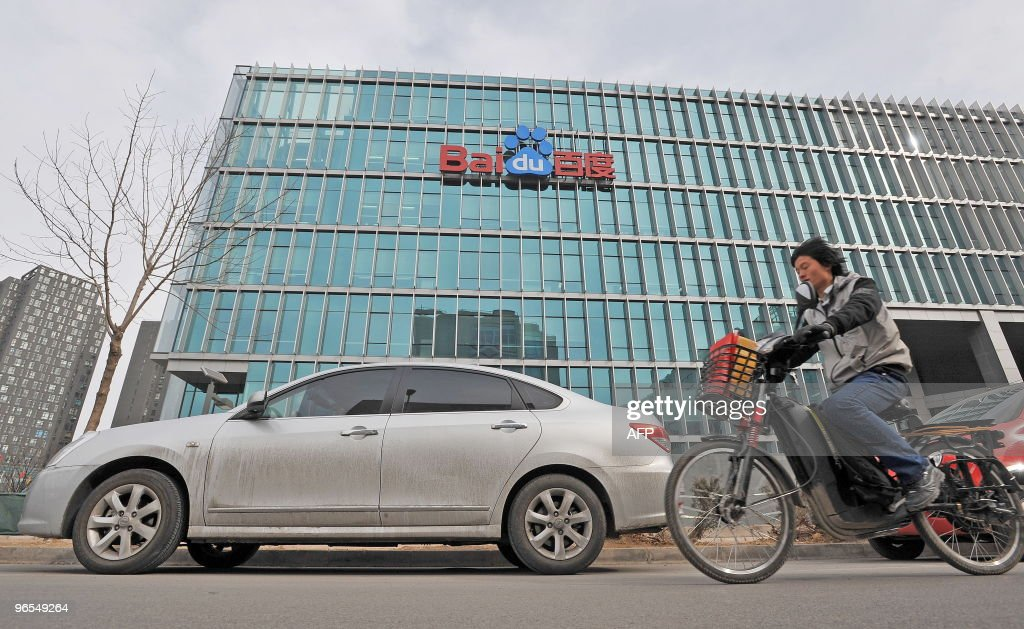 Chinese motorists pass by the Chinese Web search giant Baidu's headoffice in Beijing on February 10, 2010. The Nasdaq-listed Baidu said net profit rose 48.2 percent in the fourth quarter to 62.7 million USD while revenue increased 39.8 percent to 184.7 million USD, and it expected to benefit from growing customer confidence after Google's threat to pull out of China. AFP PHOTO/SIMON LIM