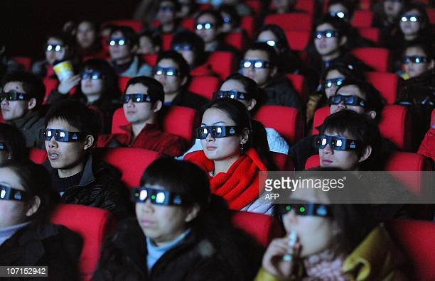 Chinese moviegoers wear 3D glasses as they watch the sciencefiction blockbuster 'Avatar' at a cinema in Hefei east China's Anhui province on January...