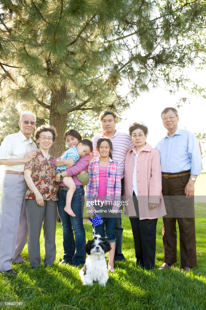 Chinese multi-generation family standing together outdoors : Stock Photo