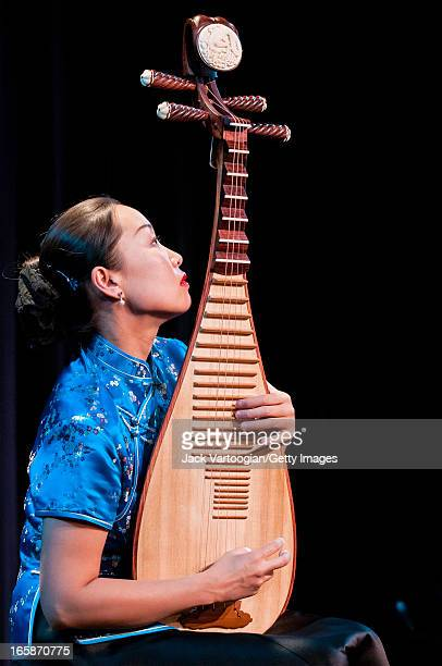 Chinese musician Liu Fang plays a pipa during the World Music Institute's 'Music of China for Pipa and Guzheng' concert at the Symphony Space's...