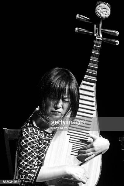 Chinese musician Wu Man plays pipa as she performs her own composition 'Night Thoughts' during the 'Music from Japan 40th Anniversary Festival' at...