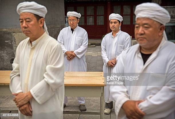 Chinese Muslim Imams of the Hui ethnic minority pray before breaking fast during the holy fasting month of Ramadan at the historic Niujie Mosque on...