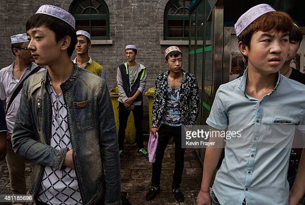 Chinese Muslims of the Hui ethnic minority wear new clothes as they wait before Eid Al Fitr prayers marking the end of the holy fasting month of...