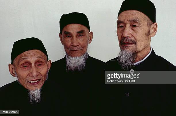 Chinese Muslims stand in a mosque in Shanghai