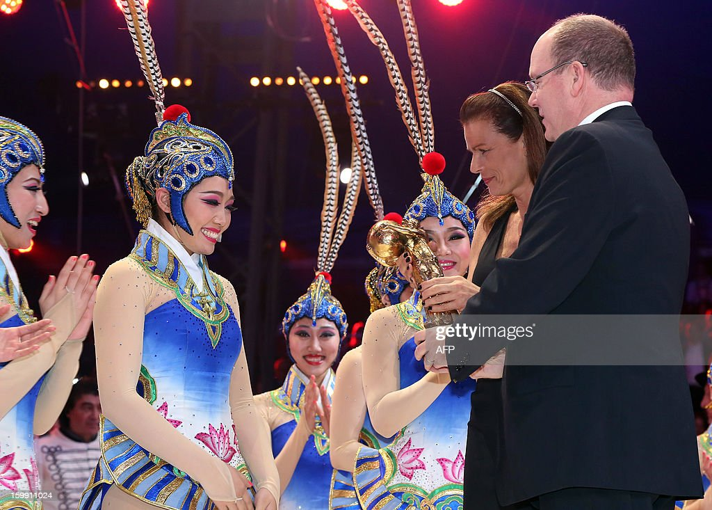 Chinese national acrobatic company of Beijing receives the 'Golden Clown' award from Princess Stephanie and Prince ALbert II of Monacoduring the official Award Gala Evening of the 37th International Circus Festival of Monte Carlo in Monaco, 22 January 2013.