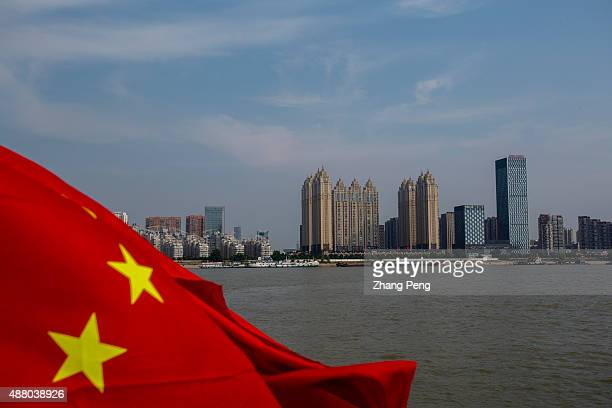 Chinese national flag is flying on the Yangtze river flowing across the city of Wuhan which is undergoing largescaled city construction On Sept10...
