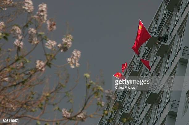 Chinese national flags are hung outside a dormitory building by students at the Beijing Institute of Technology on April 21 2008 in Beijing China A...