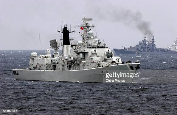 A Chinese navy vessel attends an offshore blockade exercise during the third phase of the SinoRussian 'Peace Mission 2005' joint military exercise on...
