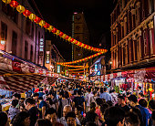 Crowd walking in the streets of Chinatown during the Chinese New Year celebrations in Singapore. Many people celebrate, eat and buy at the many market stalls that open till late at night during this p