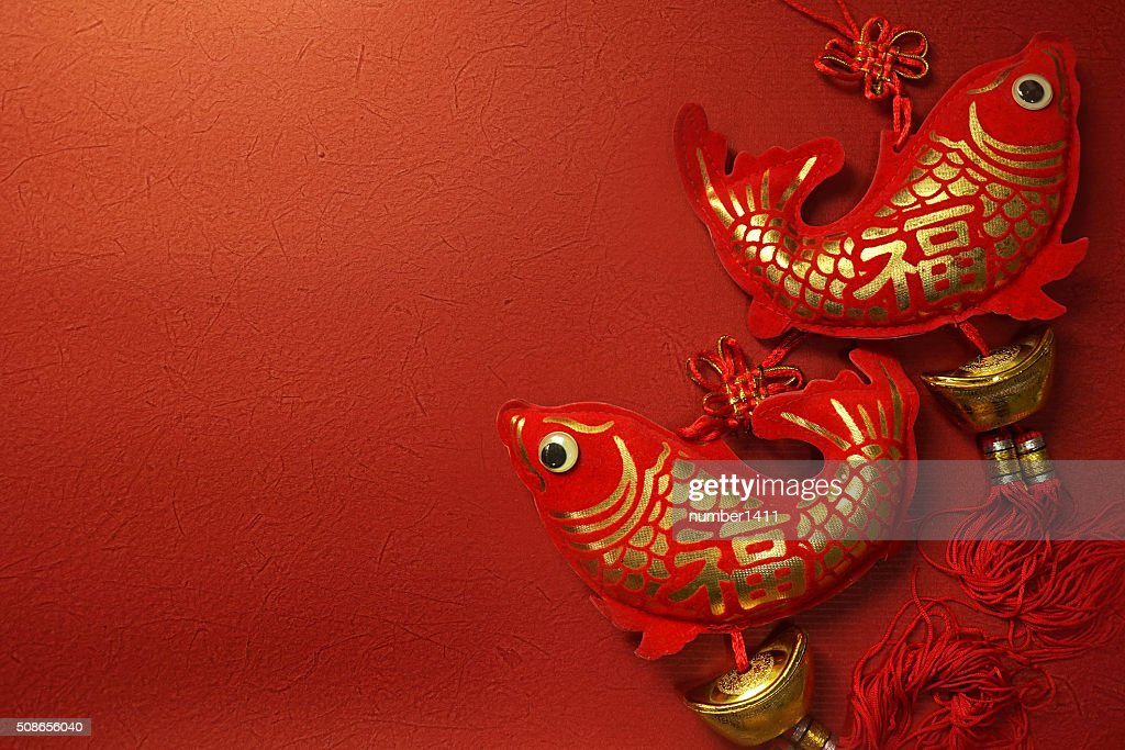 Chinese new year decoration on mulberry paper texture red background : Stock Photo