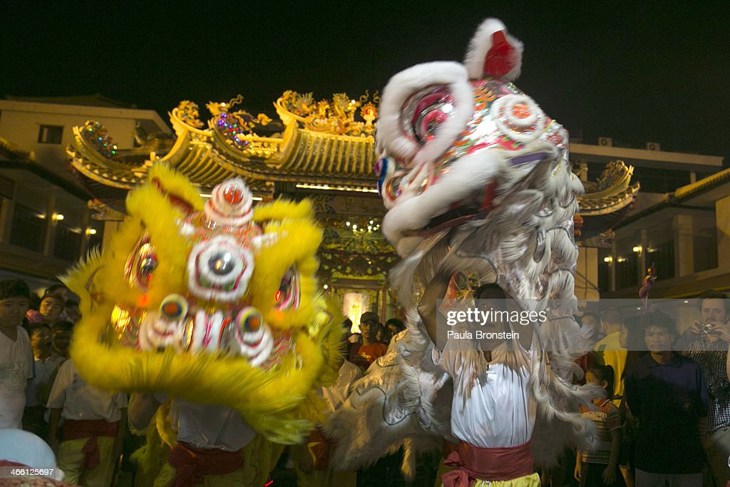 Chinese New Year entertainers perform a dragon dance inside a Chinese temple on January 31, 2014 in Bangkok, Thailand. The general elections on February 2 will take place as the anti-government protesters vow to cause disruptions by blocking polling stations in the capitol. Bangkok Shutdown has been in effect for over two weeks as the anti-government protesters continue to block major intersections. The Thai government imposed a 60-day state of emergency in Bangkok and the surrounding provinces in an attempt to cope with the on-going political turmoil, however this decree has had no effect on the mass protests.