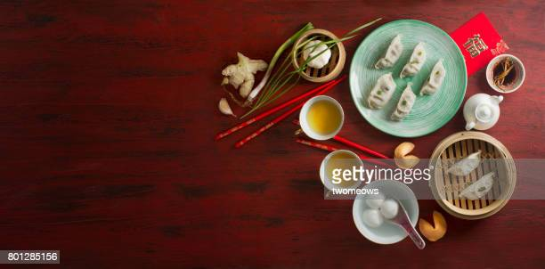 Chinese new year food and drink on red rustic background.