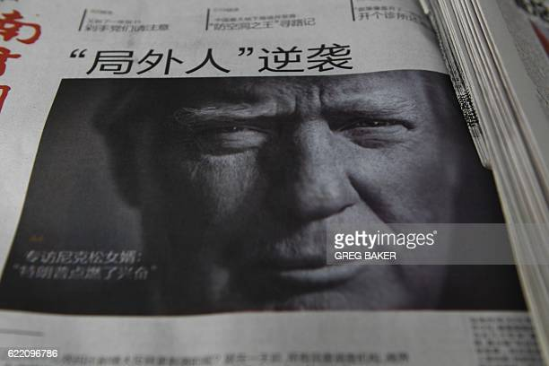A Chinese newspaper is on sale with the headline that reads 'Outsider strikes back' featuring Donald Trump on the front page in Beijing on November...