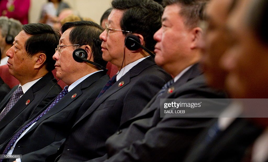 Chinese officials listen as unidentified US Secretary of State Hillary Clinton speaks during the opening session of the second round of the US-China Strategic & Economic Dialogue at the Great Hall of the People in Beijing on May 24, 2010. The US and China opened two days of high-level talks due to cover a wide range of issues including tensions over the sinking of a South Korean warship, blamed on Pyongyang. AFP PHOTO / POOL / Saul LOEB