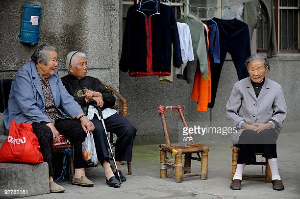 Chinese old women take a rest at a poor area that will make way for luxury apartments and two fivestar hotels in Hefei in east China's Hefei province...