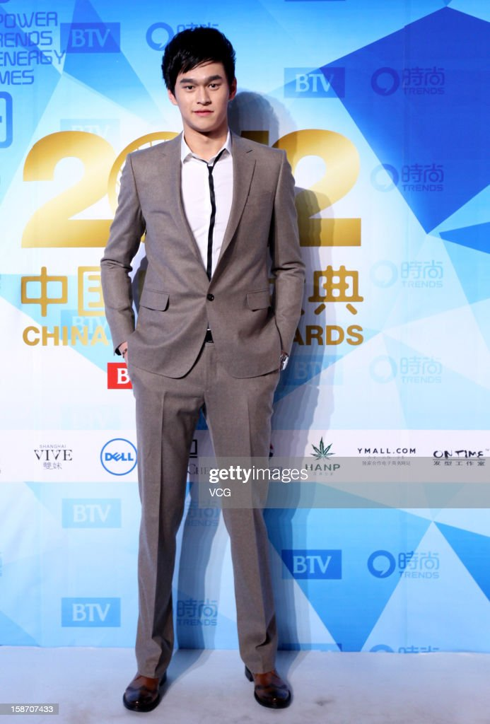 Chinese Olympic swimmer <a gi-track='captionPersonalityLinkClicked' href=/galleries/search?phrase=Sun+Yang&family=editorial&specificpeople=5492571 ng-click='$event.stopPropagation()'>Sun Yang</a> arrives at the red carpet of the 2012 China Trends Awards at BTV Grand Theater on December 22, 2012 in Beijing, China.