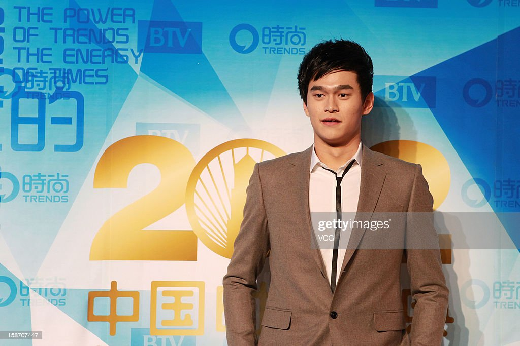 Chinese Olympic swimmer <a gi-track='captionPersonalityLinkClicked' href=/galleries/search?phrase=Sun+Yang+-+Swimmer&family=editorial&specificpeople=5492571 ng-click='$event.stopPropagation()'>Sun Yang</a> arrives at the red carpet of the 2012 China Trends Awards at BTV Grand Theater on December 22, 2012 in Beijing, China.
