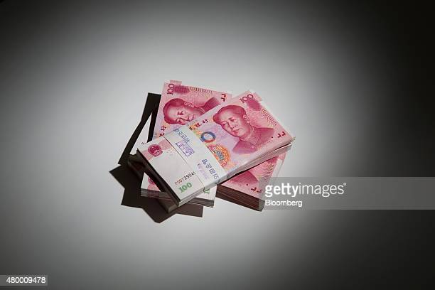 Chinese onehundred yuan banknotes are arranged for a photograph at the Korea Exchange Bank headquarters in Seoul South Korea on Thursday July 9 2015...