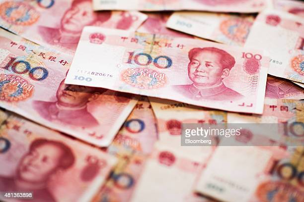 Chinese onehundred yuan banknotes are arranged for a photograph in Hong Kong China on Monday July 20 2015 The yuan has proven to be among the more...