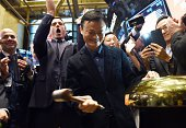 Chinese online retail giant Alibaba founder Jack Ma rings a bell to start the trading of his company's stock on the floor at the New York Stock...
