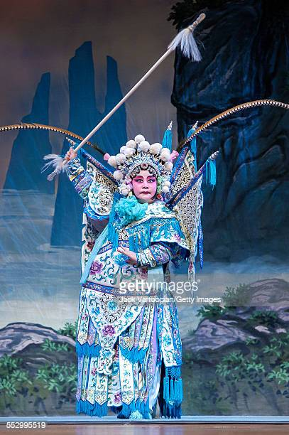 Chinese opera actor and director Qi Shu Fang performs in the 'wudan' role of 'Mu Guiying' in 'The Battle at Calabash Gorge' with her Qi Shu Fang...