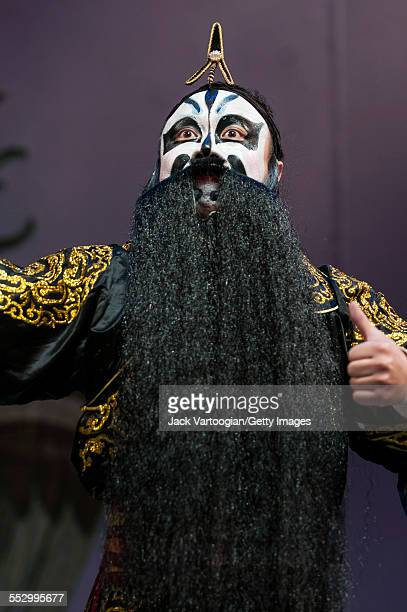 Chinese Opera actor Yang Mingde performs in 'The Crossroads' with the Qi Shu Fang Peking Opera Company at a World Music Institute concert at New York...