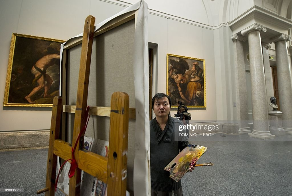 Chinese painter Guo Zhongzheng works on his painting, a copy of Titian's painting 'The emperor Charles V at Muchlberg' at the Prado Museum in Madrid on January 25, 2013. Chinese artists from the state academy and the China Academy of Art are due to make first-hand copies of some of the jewels of European oil painting and take them back to China to use for teaching.
