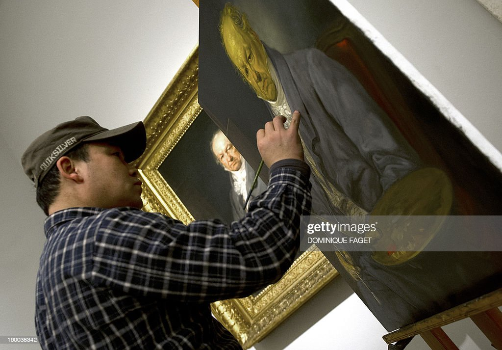 Chinese painter Sun Wengong works on his painting, a copy of Vicente Lopez's painting 'El pintor Francisco de Goya' (Painter Francisco de Goya) at the Prado Museum in Madrid on January 25, 2013. Chinese artists from the state academy and the China Academy of Art are due to make first-hand copies of some of the jewels of European oil painting and take them back to China to use for teaching.