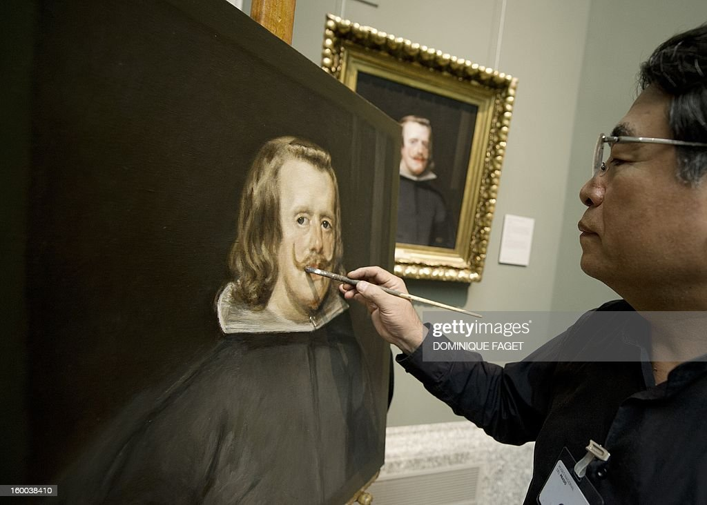 Chinese painter Yang Fei Yun works on the painting, a copy of Velazquez's paiting 'Portrait of Felipe IV' at the Prado Museum in Madrid on January 25, 2013. Chinese artists from the state academy and the China Academy of Art are due to make first-hand copies of some of the jewels of European oil painting and take them back to China to use for teaching.