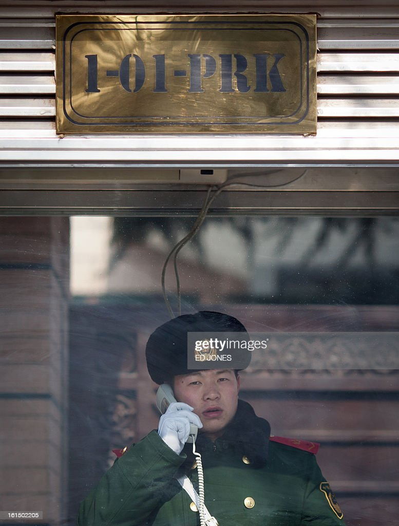 A Chinese paramilitary guard speaks on the phone outside the North Korean embassy in Beijing on February 12, 2013. North Korea's apparent nuclear test had an explosive yield of between six and seven kilotons, South Korea's defence ministry said, revising its earlier estimate of 10 kilotons or more. Ministry spokesman Kim Min-Seok said seismic monitors had detected a tremor with a 4.9 magnitude emanating from the North's nuclear test site. AFP PHOTO / Ed Jones