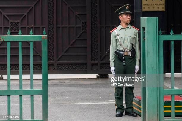 A Chinese paramilitary guard stands at the North Korean Embassy in Beijing on September 15 2017 North Korea fired a ballistic missile over Japan and...