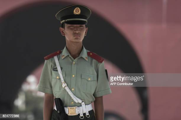 A Chinese paramilitary guard stands in front of The Forbidden City in Beijing on July 31 on the eve of the 90th founding anniversary of the People's...