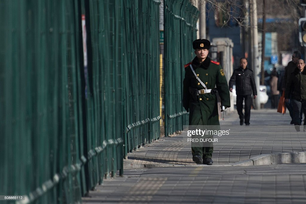 A Chinese paramilitary guard walks next to the North Korean Embassy in Beijing on February 7, 2016. North Korea hailed an 'epochal event' but its latest long-range rocket launch on February 7 prompted international anger and plans for talks on a missile defence system for the peninsula. AFP PHOTO / FRED DUFOUR / AFP / FRED DUFOUR