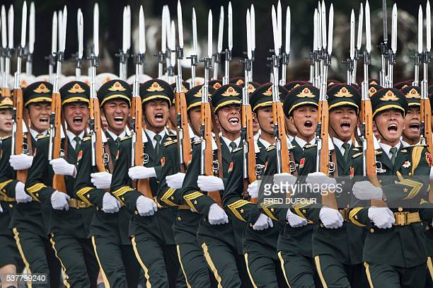 TOPSHOT Chinese paramilitary guards parade during the welcome ceremony for Cambodian King Norodom Sihamoni at the Great Hall of the People in Beijing...