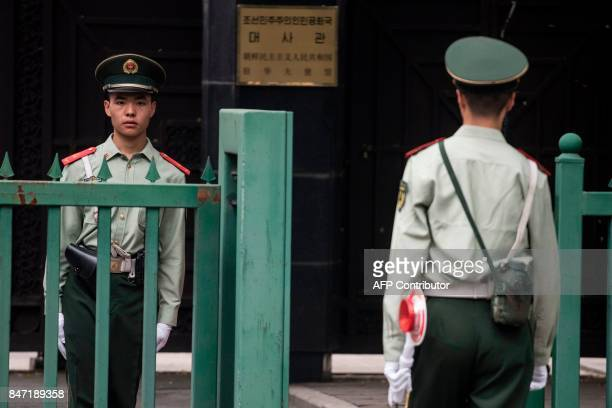 Chinese paramilitary guards stand at the North Korean Embassy in Beijing on September 15 2017 North Korea fired a ballistic missile over Japan and...