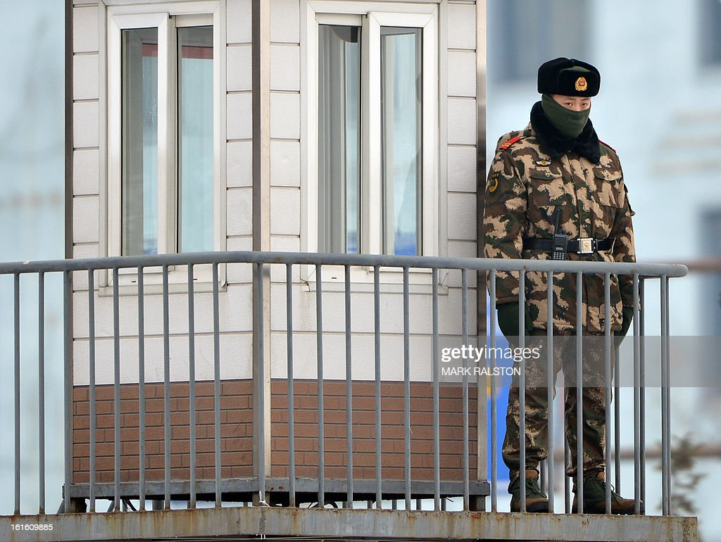 A Chinese para-military officer keeps watch on the Sino-Korean Friendship Bridge linking the North Korean town of Sinuiju with the Chinese city of Dandong, on February 13, 2013. While the rest of the world reacted with outrage, North Koreans were swept up in a 'storm of excitement' over their country's latest nuclear test, state media reported. The countries third nuclear test was widely condemned by the international community, led by the United States and the UN Security Council, which met in emergency session the same day. AFP PHOTO/Mark RALSTON