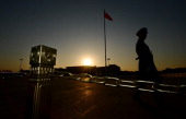 A Chinese paramilitary officer patrols Tiananmen Square in front of the Great Hall of the People after the Communist Party Central Committee's...