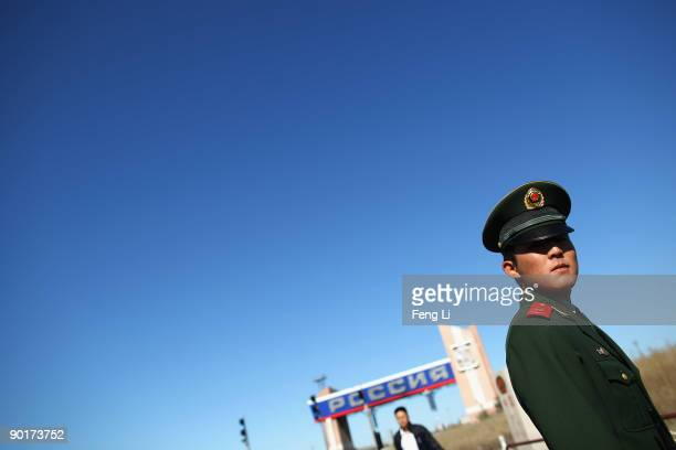 Chinese paramilitary officer stands guards at the SinoRussia border on August 28 2009 in Manzhouli Hulun Buir League of the Inner Mongolia Autonomous...