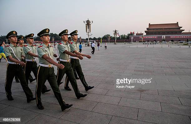 Chinese Paramilitary officers march in Tiananmen Square on June 3 2014 in Beijing China Twentyfive years ago on June 4 1989 Chinese troops cracked...