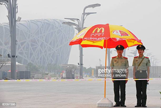 Chinese paramilitary police man their post in a restricted area near the main Olympics stadium also known as the Bird's Nest on July 26 2008 in...