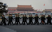 Chinese paramilitary police march away from Tiananmen Square during the National People's Congress in Beijing on March 7 2014 China's annual show of...